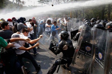 Anti-government protesters clash with police during a protest in Caracas